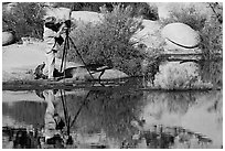 Photographer with large format camera at Barker Dam. Joshua Tree National Park, California, USA. (black and white)