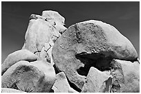 Rocks with climbers in a distance. Joshua Tree National Park, California, USA. (black and white)