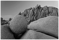 Round granite boulder and triangular rocks, dusk. Joshua Tree National Park ( black and white)