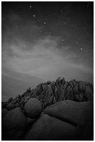 Geometrically shaped rocks and stars at night. Joshua Tree National Park ( black and white)