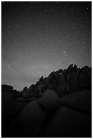 Marble rocks under clear starry sky. Joshua Tree National Park ( black and white)