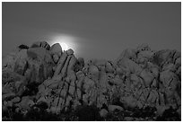 Moonset over rocks delimiting Hidden Valley. Joshua Tree National Park ( black and white)
