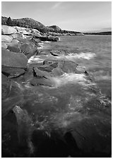 Pink granite slabs on the coast near Otter Point, morning. Acadia National Park, Maine, USA. (black and white)
