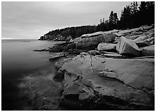 Coastline with granite slabs near Otter Point, sunrise. Acadia National Park, Maine, USA. (black and white)