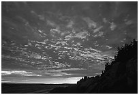 Sunset sky, Bass Harbor lighthouse. Acadia National Park, Maine, USA. (black and white)