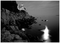 Bass Harbor lighthouse by night with moon reflection in ocean. Acadia National Park, Maine, USA. (black and white)
