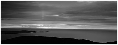 Red clouds over ocean at sunrise. Acadia National Park (Panoramic black and white)