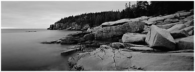 Rocky coastline with granite slabs. Acadia National Park (Panoramic black and white)