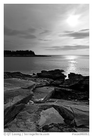 Rock slabs and sun over ocean, Schoodic Peninsula. Acadia National Park (black and white)
