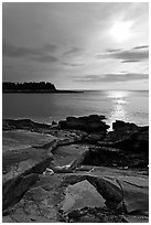 Rock slabs and sun over ocean, Schoodic Peninsula. Acadia National Park ( black and white)