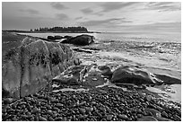 Seascape with pebbles, waves, and island, Schoodic Peninsula. Acadia National Park, Maine, USA. (black and white)