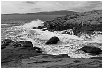 Wave, Schoodic Point, and Cadillac Mountain. Acadia National Park, Maine, USA. (black and white)