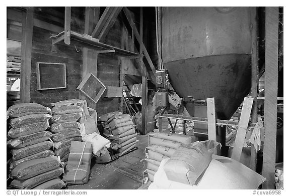 Grain distributor and bags of  seeds in Wilson feed mill. Cuyahoga Valley National Park (black and white)