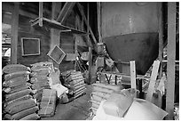 Grain distributor and bags of  seeds in Wilson feed mill. Cuyahoga Valley National Park ( black and white)