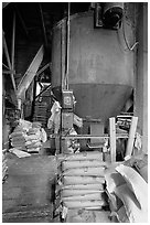 Distributor and bags of bird seeds in Wilson feed mill. Cuyahoga Valley National Park, Ohio, USA. (black and white)