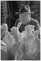 Miller sitting behind bags of cornmeal, North Carolina. Great Smoky Mountains National Park ( black and white)