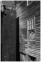 Miller standing at window, Mingus Mill, North Carolina. Great Smoky Mountains National Park, USA. (black and white)