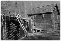 Miller climbing onto millrace, Mingus Mill, North Carolina. Great Smoky Mountains National Park, USA. (black and white)