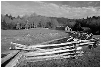 Wooden fence, pasture, and cabin, late afternoon, Cades Cove, Tennessee. Great Smoky Mountains National Park, USA. (black and white)