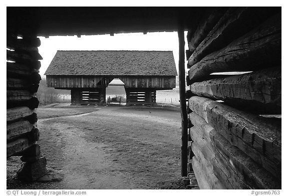 Cantilever barn framed by doorway, Cades Cove, Tennessee. Great Smoky Mountains National Park (black and white)