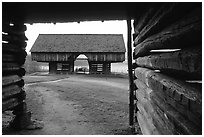 Cantilever barn framed by doorway, Cades Cove, Tennessee. Great Smoky Mountains National Park, USA. (black and white)