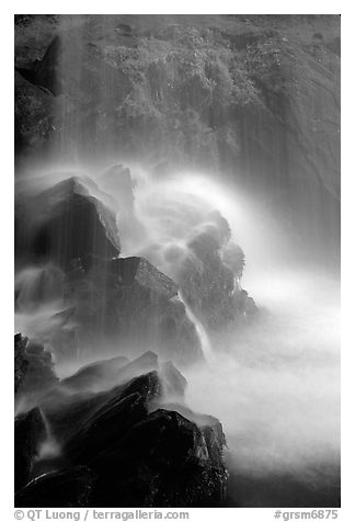 Misty water falling on dark rocks, Grotto falls, Tennessee. Great Smoky Mountains National Park (black and white)