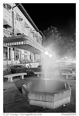 Fountain with thermal steam outside Fordyce Bath at night. Hot Springs National Park (black and white)