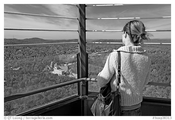 Tourist looking at the view from Hot Springs Mountain Tower in the fall. Hot Springs National Park (black and white)