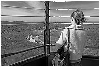 Visitor looking at the view from Hot Springs Mountain Tower in the fall. Hot Springs National Park, Arkansas, USA. (black and white)