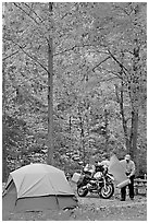 Tent and motorcycle camper under trees in fall colors. Hot Springs National Park, Arkansas, USA. (black and white)