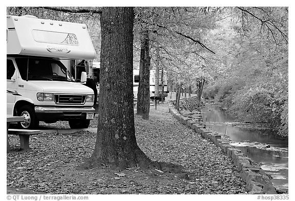 RV, trees in fall colors, and stream. Hot Springs National Park (black and white)
