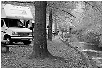RV, trees in fall colors, and stream. Hot Springs National Park, Arkansas, USA. (black and white)