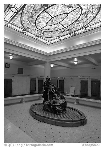 Court with stained glass roof in Fordyce bathhouse. Hot Springs National Park (black and white)
