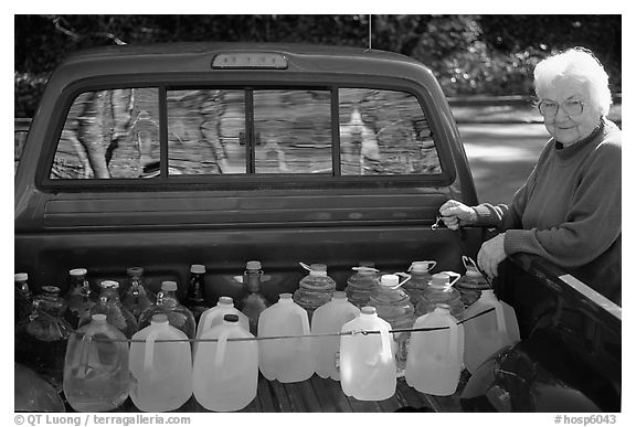 Resident stocks up on natural spring water. Hot Springs National Park (black and white)