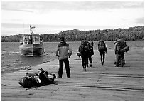 Backpackers waiting for pick-up by the ferry at Windego. Isle Royale National Park, Michigan, USA. (black and white)