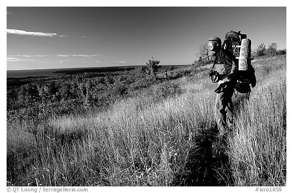 Backpacker pausing on Greenstone ridge trail. Isle Royale National Park (black and white)