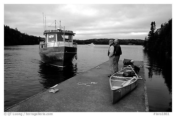 Canoists waiting for pick-up by the ferry at Chippewa harbor. Isle Royale National Park (black and white)