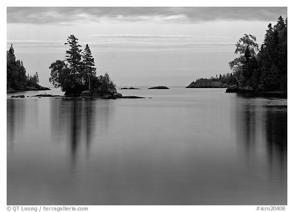 Tree-covered islet and smooth waters, Chippewa Harbor. Isle Royale National Park (black and white)