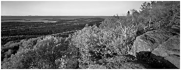 Rocky bluff overlooking island with Lake Superior in the distance. Isle Royale National Park (Panoramic black and white)