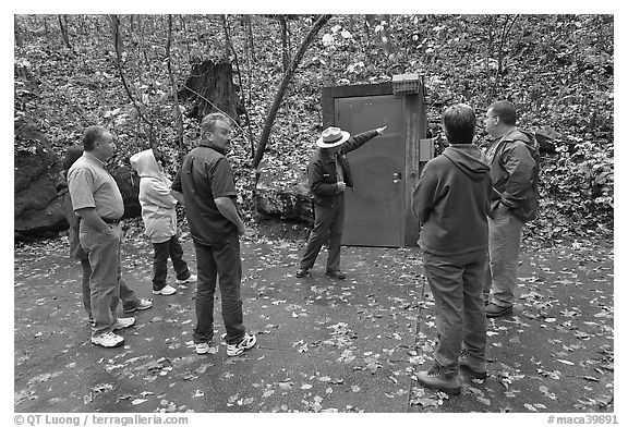 Ranger pointing to cave entrance to tourists. Mammoth Cave National Park (black and white)
