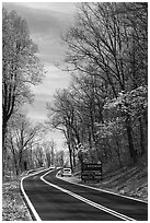 Skyline drive with cars and Park entrance sign. Shenandoah National Park ( black and white)