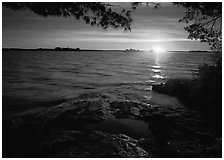 Sun rising over Kabetogama Lake. Voyageurs National Park, Minnesota, USA. (black and white)