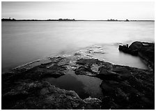Lake and eroded granite at sunrise. Voyageurs National Park, Minnesota, USA. (black and white)