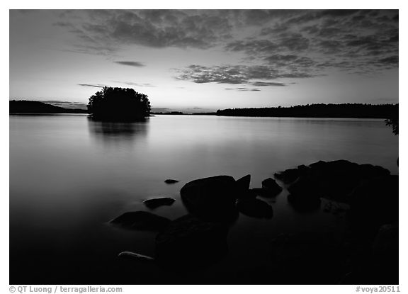Kabetogama lake sunset with eroded granite and tree-covered islet. Voyageurs National Park (black and white)