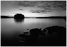 Kabetogama lake sunset with eroded granite and tree-covered islet. Voyageurs National Park, Minnesota, USA. (black and white)