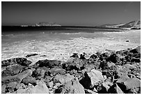 Surf foam and rocks, Cuyler Harbor, mid-day, San Miguel Island. Channel Islands National Park, California, USA. (black and white)