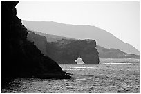 Coastline with sea arch, Santa Cruz Island. Channel Islands National Park, California, USA. (black and white)