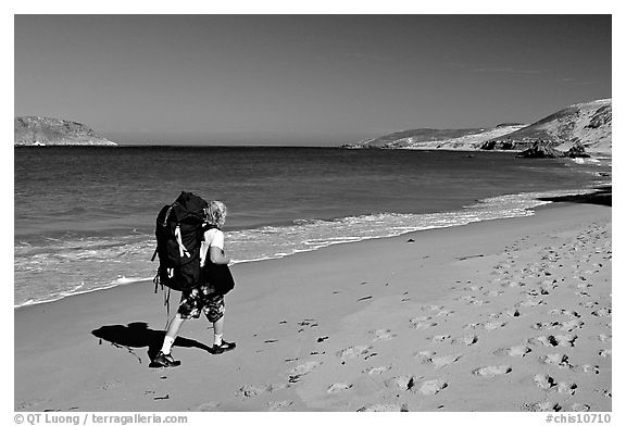 Backpacker on beach, Cuyler harbor, San Miguel Island. Channel Islands National Park (black and white)