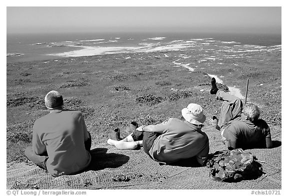 Hikers observing Point Bennett from a distance, San Miguel Island. Channel Islands National Park (black and white)