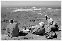Hikers observing Point Bennett from a distance, San Miguel Island. Channel Islands National Park, California, USA. (black and white)